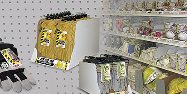 A retail facility with Workhorse safety supplies neatly organized on white shelves.