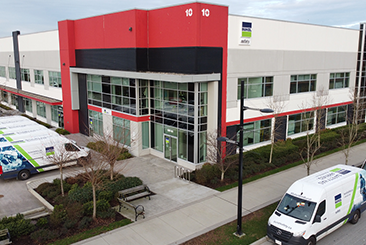 A Bunzl Safety office building with cars in the parking lot.